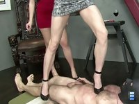 Mistress Bijou and Goddess Therapy continue their assault on the human carpet.
