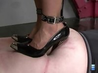Cruel Beauty: They grind their heels in deeply and enjoy making out a bit as he suffers beneath them!